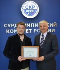 Павел Сахаров слева