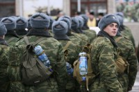 New conscripts march as they depart from Russia's Siberian city of Barnaul