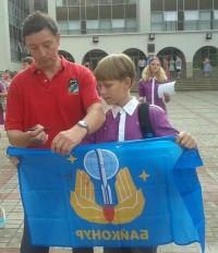 Автограф космонавта Ревина на флаге.